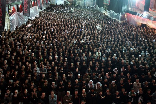 Pilgrims pray at the Imam al-Abbas shrine during Ashura in Kerbala, about 80 km southwest of Baghdad in Iraq. (Photo: REUTERS/Mushtaq Muhammed)