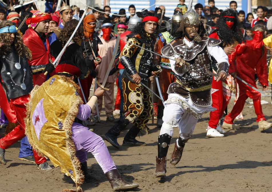Local actors dressed as ancient warriors re-enact a scene from the 7th century battle of Kerbala in Baghdad's Sadr City. (Photo: REUTERS/Thaier Al-Sudani)
