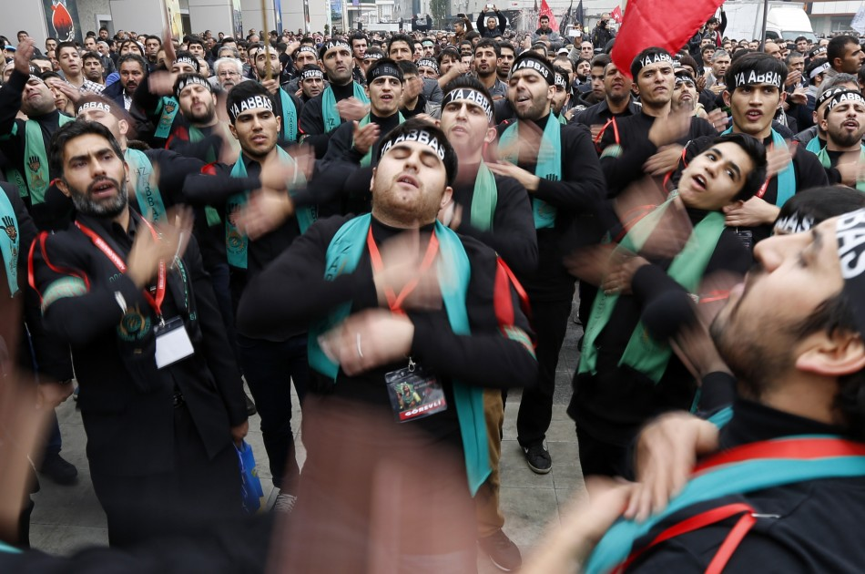 Turkish Shi'ite men beat their chests as they mourn during an Ashura procession in Istanbul. (Photo: REUTERS/Murad Sezer)