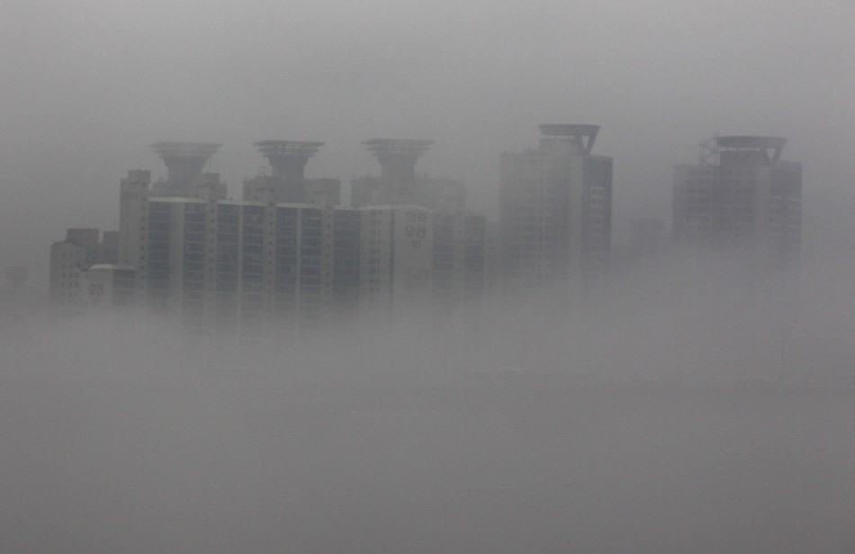 An apartment complex in Seoul shrouded in fog in July, 2011.