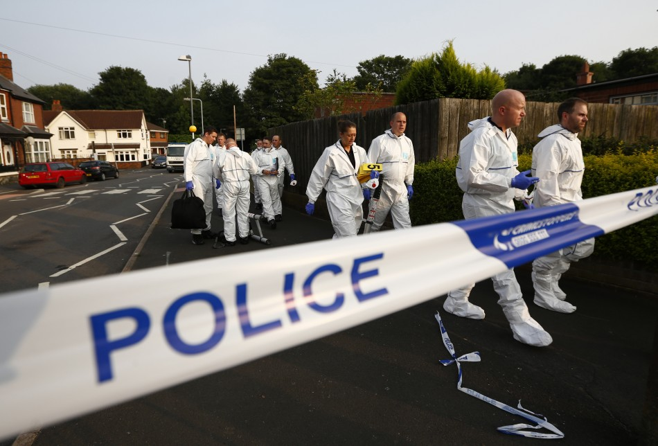 Specialist police officers recovered a body from the bottom of a well in Surrey.