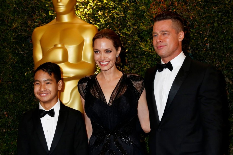 Angelina Jolie and partner Brad Pitt and son Maddox arrive at the fifth Annual Academy of Motion Picture Arts and Sciences Governors Awards in Hollywood November 16, 2013.  (Reuters)