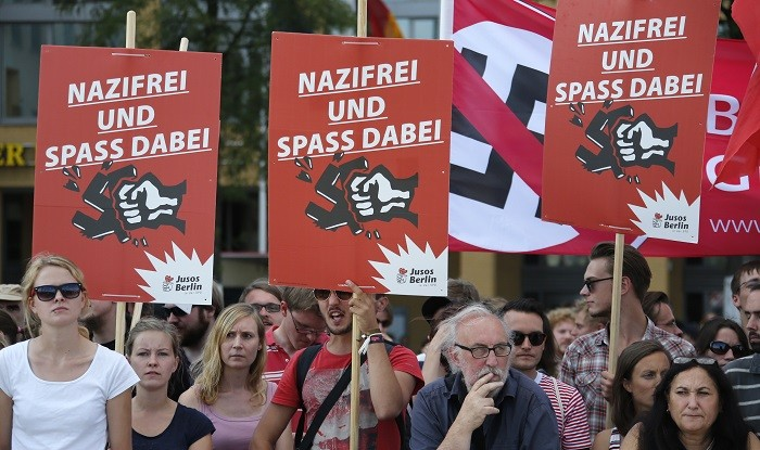 Protesters in Germany shout slogans against the far-right National Democratic Party. (Reuters)