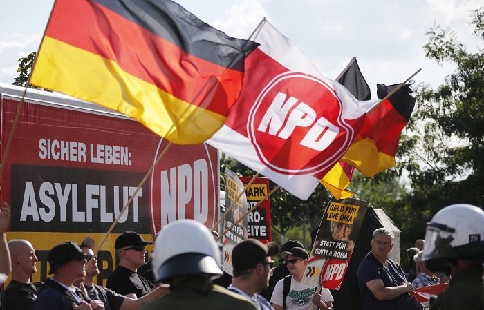 Far-right National Democratic Party supporters protest against asylum seekers in Germany. (Reuters)