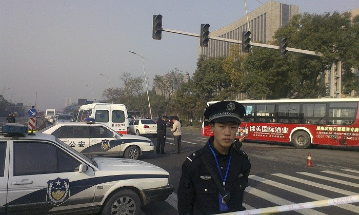 Two police officers were killed and a further two injured in an attack in Xinjiang, which left nine attackers dead. (Reuters)