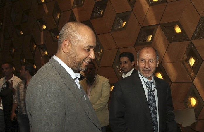 Mustafa Noah (left) with Libyan National Transitional Council chairman Mustafa Abdel Jalil. (Reuters)