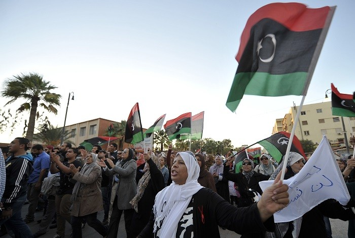 Libyan protesters demonstrate against the presence of militias who refuse to disarm two years after ousting Gaddafi from power. (Reuters)