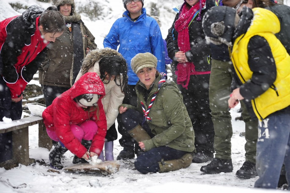 Braving the cold weather Kate Middleton, then five months pregnant, attends a scouting event in Cumbria in March 2013. (Photo: REUTERS/Andy Stenning)