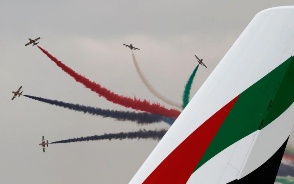 Al Fursan, the aerobatics demonstration team of the United Arab Emirates Air Force, performs during the Dubai Airshow November 17, 2013. (Reuters)