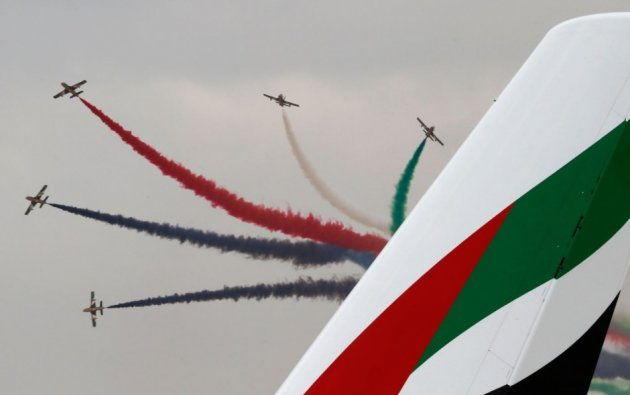 Al Fursan, the aerobatics demonstration team of the United Arab Emirates Air Force, performs during the Dubai Airshow November 17, 2013. (Reuters)