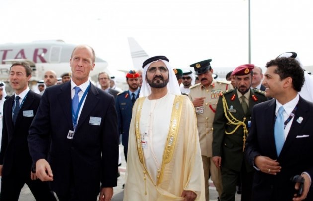 United Arab Emirates' Prime Minister and Ruler of Dubai Sheikh Mohammed bin Rashid al-Maktoum (front, 2nd R) walks with EADS Chief Executive Tom Enders (2nd L) while on a tour at the opening of the Dubai Airshow November 17, 2013.  (Reuters)