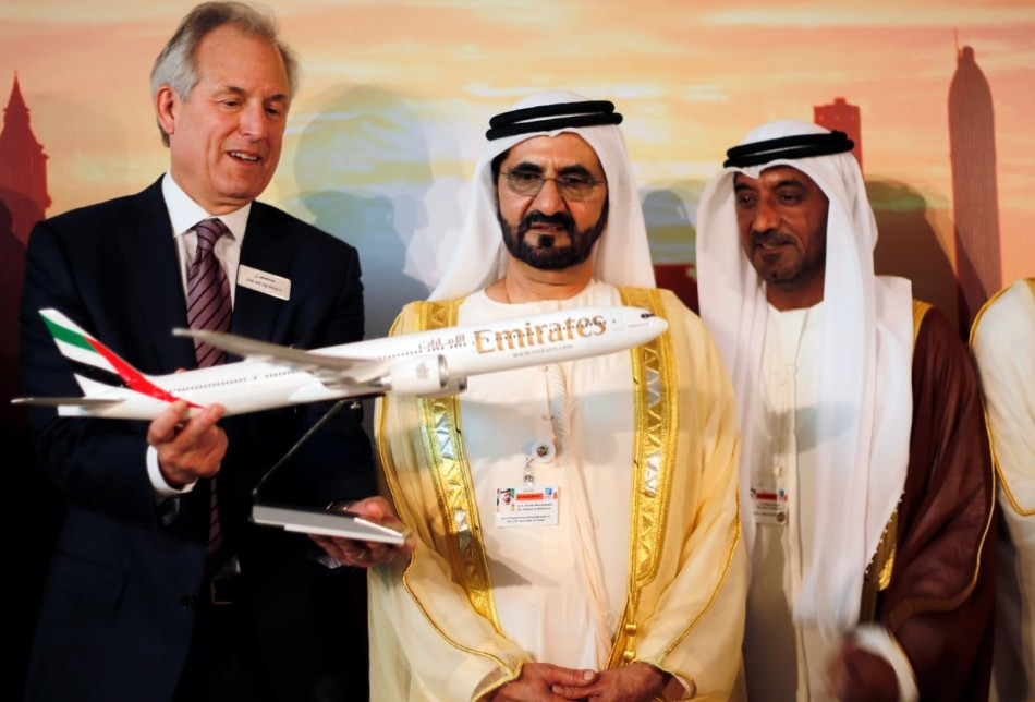 Boeing Chairman James McNerney (L) shows United Arab Emirates' Prime Minister and Ruler of Dubai Sheikh Mohammed bin Rashid al-Maktoum (2nd R) a model of the new version of its 777 long-haul jet during the Dubai Airshow (Reuters)
