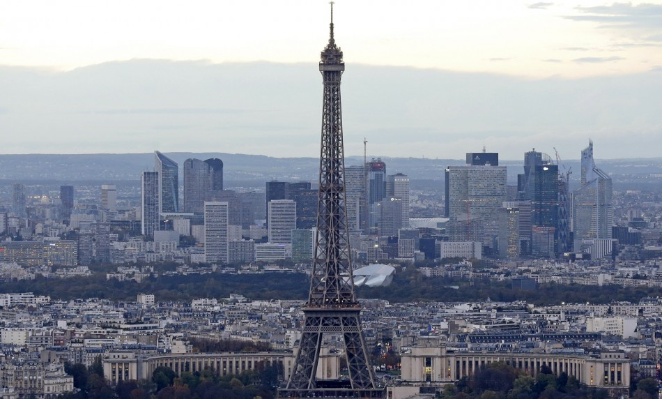A general view shows the Eiffel Tower and La Defense business district (background) in Paris