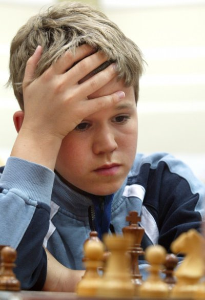 13 year old Norwegian Magnus Carlsen concentrates during a match with Belarus player Alexei Fedorov in the Dubai Open Chess championship in April 2004