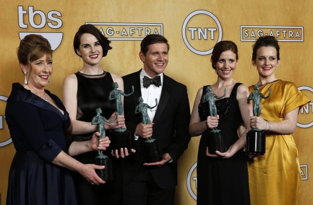 ITV broadcasts popular dramas such as Downton Abbey. Here, Cast members of the TV drama Downton Abbey hold their award for
