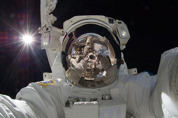 International Space Station astronaut Aki Hoshide, from Japan, takes a selfie on space walk (Nasa)