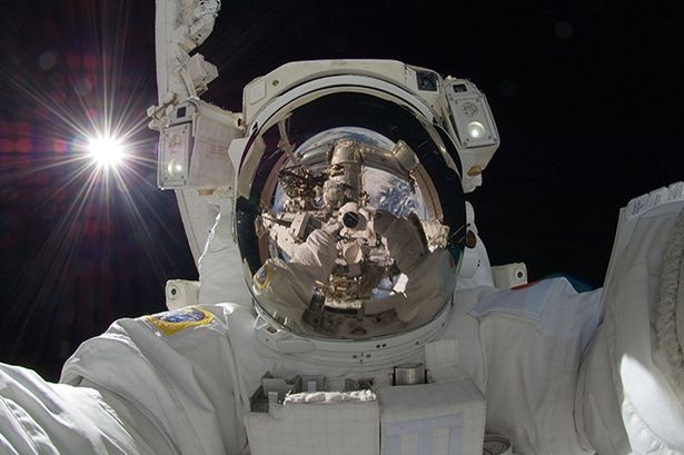 International Space Station astronaut Aki Hoshide, from Japan, takes a selfie on space walk (Nasa)