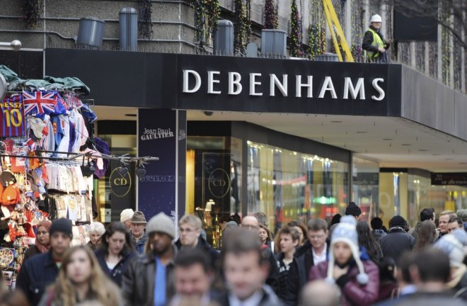 People walk past Debenhams department store on Oxford Street, in central London. Retailers have started offering discount ahead of Thanksgiving, Black Friday and Christmas. (Photo: REUTERS/Ki Price)