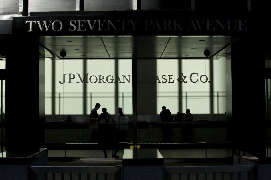 People walk inside JP Morgan headquarters in New York