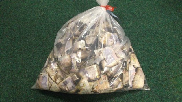 Filthy lucre: Dirty notes hauled from river Spalding PIC: Lincolnshire police