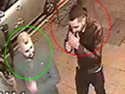 Man in green circle sought by police for needle attack suspect, circled in red (West Midlands Police)