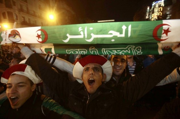 Fans of Algeria's soccer team celebrate in downtown Algiers after their team defeated Burkina Faso in their 2014 World Cup qualifying second leg playoff soccer match