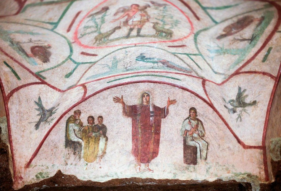 Fresco inside the catacomb of Priscilla in Rome depicts a young woman, which women group say is a priest. (Photo: REUTERS/Max Rossi)