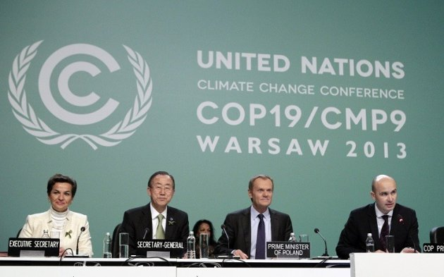 (L-R) Christiana Figueres, executive secretary of the UN Framework Convention on Climate Change (COP), UN Secretary General Ban Ki-moon and Polish Prime Minister Donald Tusk listen to Polish Environment Minister Marcin Korolec during the COP19 conference