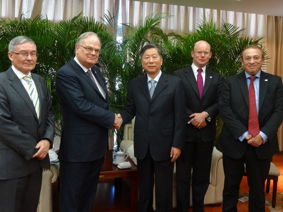 (L-R) Alan Chick, Chairman of Richmond Fiduciary Group; Peter Harwood, Guernsey's Chief Minister; Shang Fulin, Chairman of the China Banking Regulatory Commission; William Mason, Director General of the Guernsey Financial Services Commission; and Kevin St