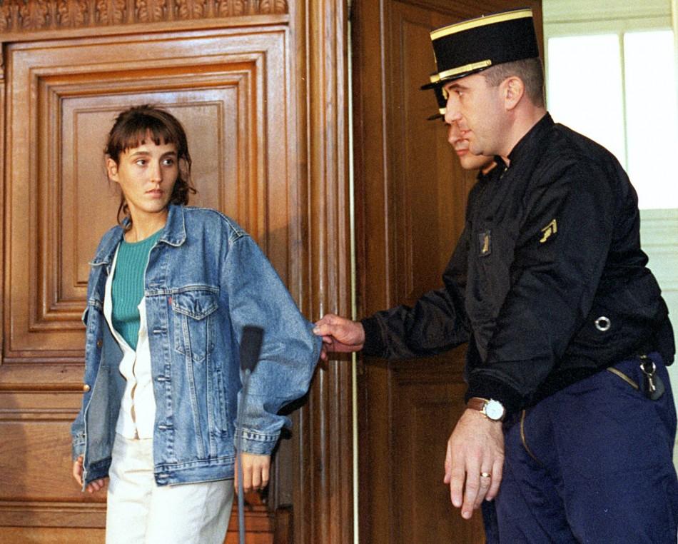 French gendarmes escort Florence Rey (L) into court