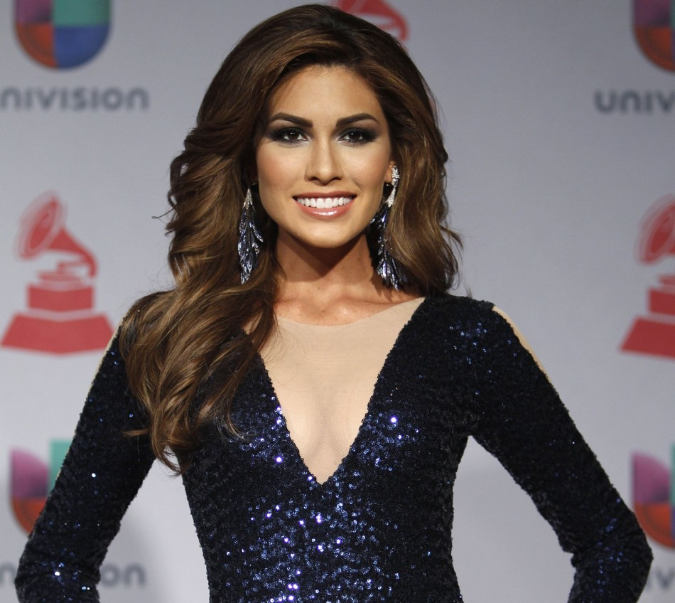 Miss Universe, Maria Gabriela Isler of Venezuela, poses backstage during the 14th Latin Grammy Awards in Las Vegas, Nevada November 21, 2013. (Photo: REUTERS/Steve Marcus)
