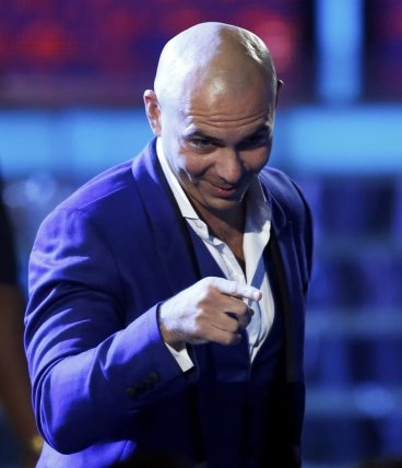 Pitbull accepts the Best Urban Peformance award for his song