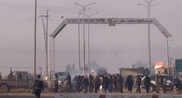 Footage apparently showing Syrian rebels in the al-Omar oil field, Deir al-Zor province.