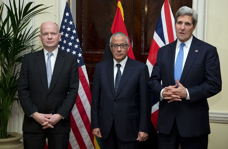 US Secretary of State John Kerry (R) speaks to the media as British Foreign Secretary William Hague (L) and Libyan Prime Minister Ali Zeidan stand with him at the Winfield House, the residence of the US Ambassador to Britain, on 24 November, 2013. (Photo: