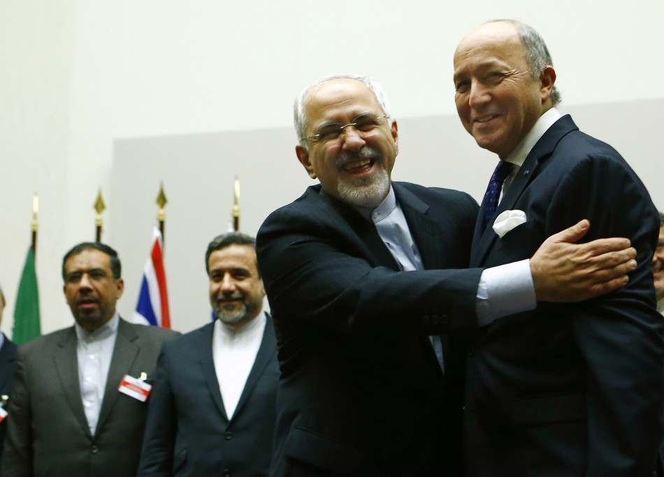 Iran's foreign minister Mohammad Javad Zarif (L) hugs his French counterpart, Laurent Fabius