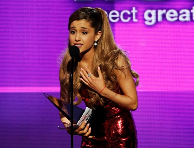 Singer Ariana Grande accepts the Kohl's new artist of the year award