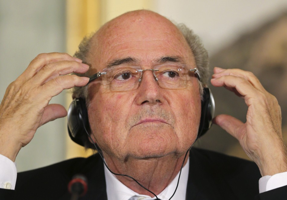 FIFA President Sepp Blatter speaks during a news conference in Doha