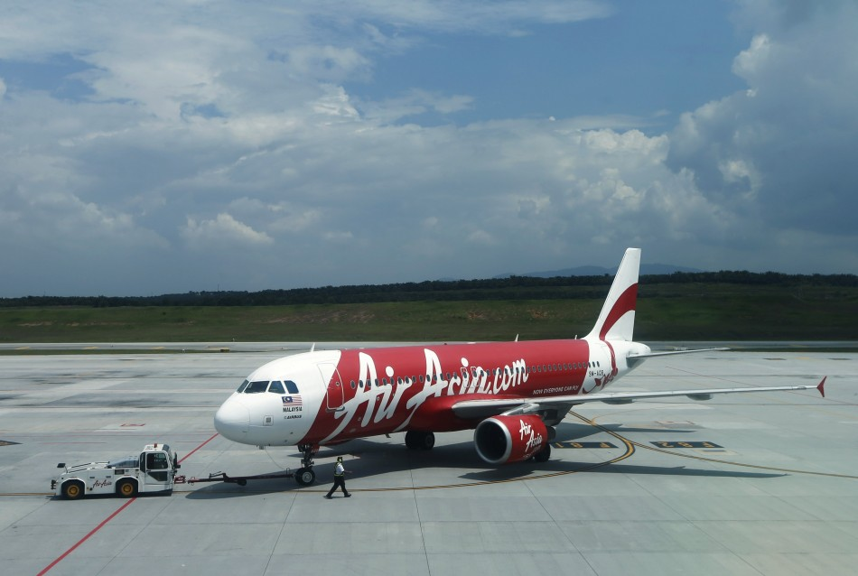 Authorities checking reports of missing Air Asia flight crashing in East Pacific Islands