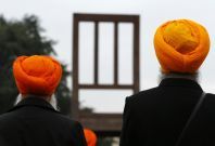 Sikh minority representatives stand in front of the European headquarters of the United Nations in Geneva