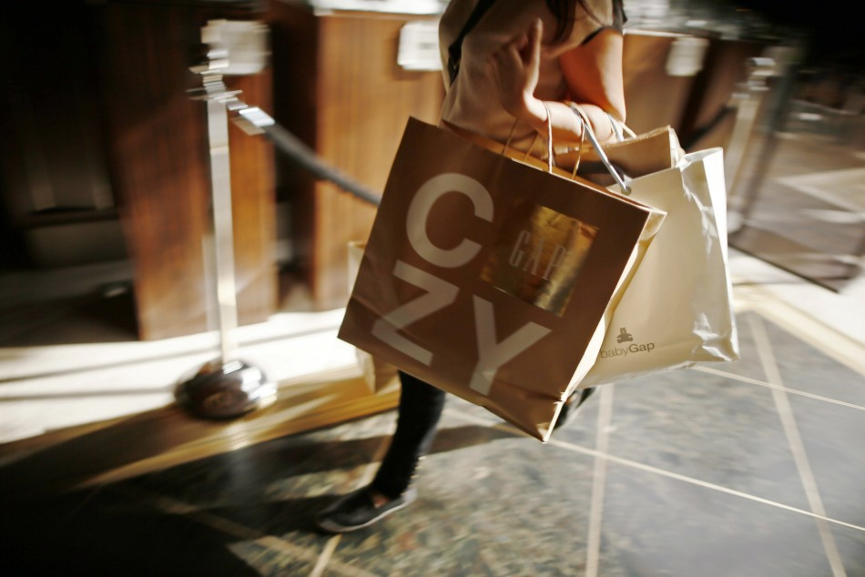 Shopper carries Gap shopping bags at The Grove mall in Los Angeles