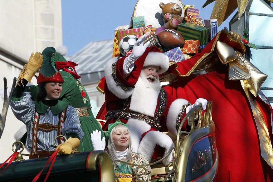 Santa and his elves on a float in Central Park West during the Thanksgiving Day Parade, New York