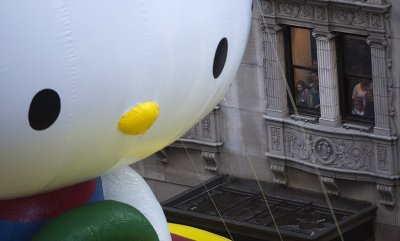 Huge size of Hello Kitty inflatable is clear in 6th Avenue during the Thanksgiving Day Parade in New York
