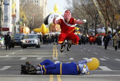Clown leaps over comrades before the start of the Thanksgiving Day Parade in New York