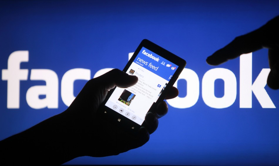 A smartphone user shows the Facebook application on his phone in Zenica, in this file photo illustration