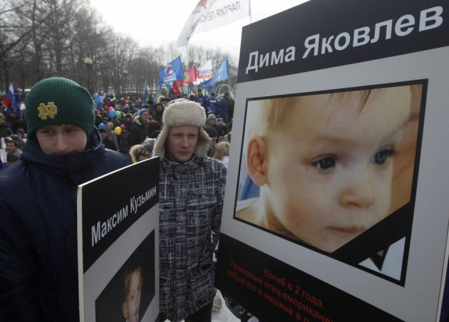People take part in a rally in defence of Russian children in Moscow