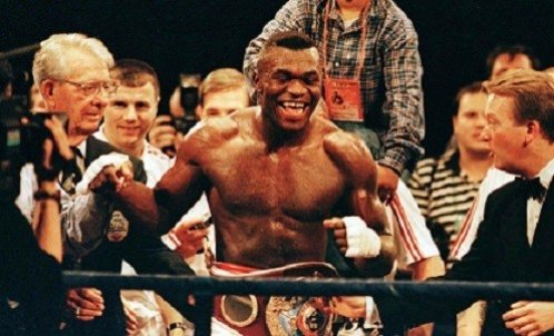 Hide (C) celebrates after winning the WBO Heavy Weight championship in 1997 (Reuters)