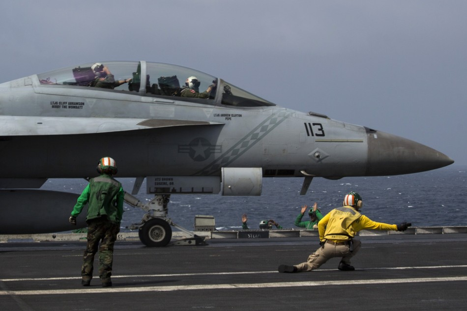 China scrambles fighter jets as US caves in