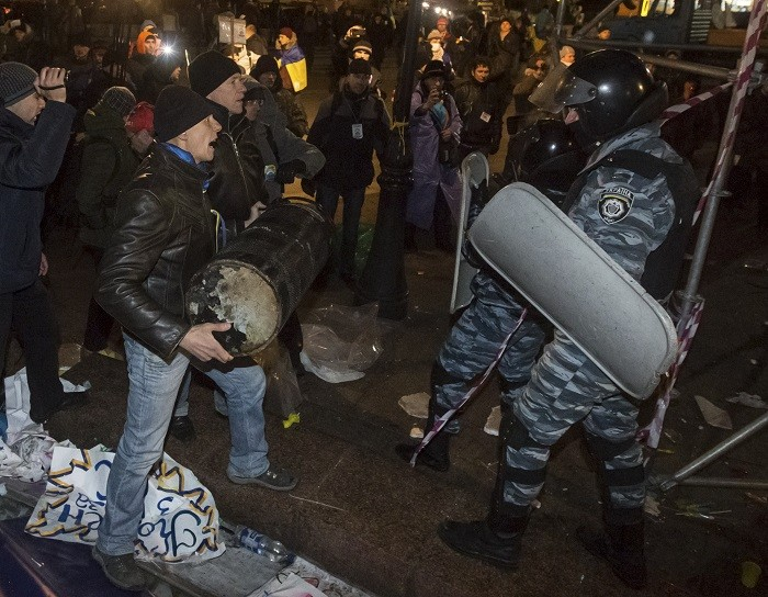 Riot police crash with pro-EU protesters in Ukraine's Independence Square on Saturday. (Reuters)