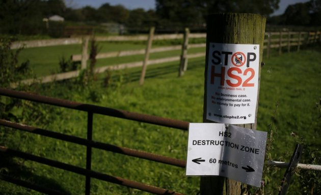 An anti high speed rail project (HS2) banner is seen nailed to a fence post near the village of Pickmere, northern England