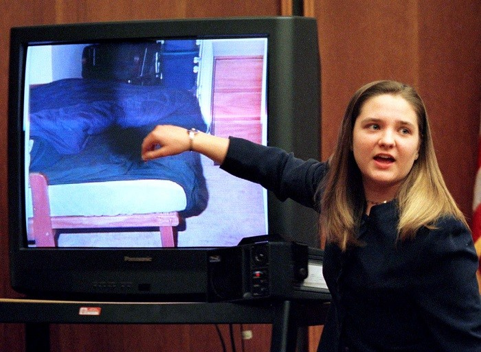 During her murder trial, Louise Woodward points to a bed where she put baby Matthew on the day he was taken to hospital. (Reuters)